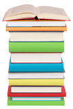 Opened book on a stack of books. Isolated on white royalty free stock images