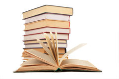 Opened book and stack of books Royalty Free Stock Photos