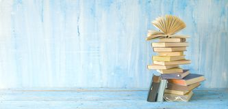 Opened book on a stack of books panorama format.Good copy space. Opened book on a stack of books panorama, good copy space. Education, reading, literature royalty free stock photos