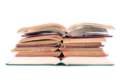 Opened books. Opened book pile isolated on white stock photography