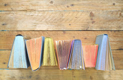Opened books, flat lay. Multicolored open books. Flat lay on grungy wooden table, good copy space royalty free stock image