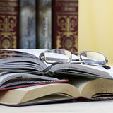 Opened books and glasses Royalty Free Stock Photography