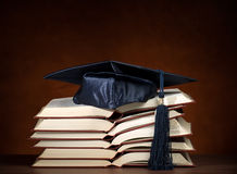 Opened books with graduation cap. Stack of opened books and graduation cap, for various education,graduation or knowledge themes Stock Photography