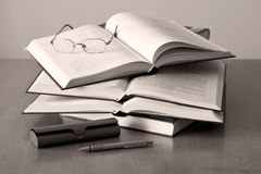 Opened books pen and glasses Royalty Free Stock Photo