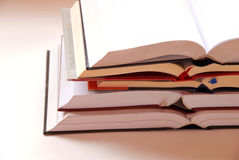 Opened books stack. Five opened large books in stack stock photos