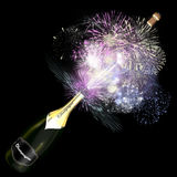 Opened bottle of champagne with giant fireworks. Stock Image