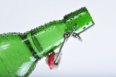 Opened bottle in dew 2. Opened bottle in dew of green color stock image