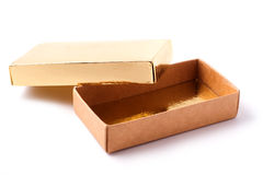Opened box. Opened golden giftbox. White background and clipping path Stock Photography
