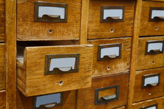 Opened box archive storage, filing cabinet interior. Vintage wooden boxes with blank index cards. library service and Royalty Free Stock Image