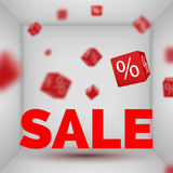 Opened Box room with SALE text and red 3d discount boxes.  Stock Photo