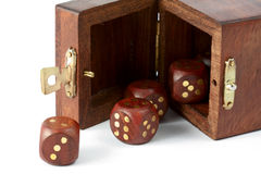 Opened box with wooden dice Stock Photography