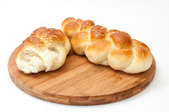 Opened braid from the bakery on a kitchen wooden board Stock Photo