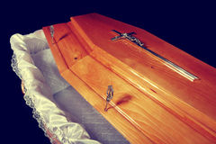 Opened brown coffin, inside close-up view stock photography
