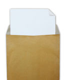 Opened brown envelope with white paper Stock Photo