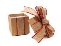 Opened brown gift box with rustic burlap bow and ribbon Stock Images