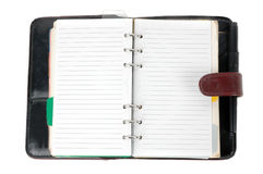 An opened brown leather notebook. Isolated on white background Royalty Free Stock Image
