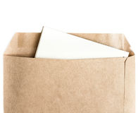 Opened brown Recycled craft  envelope with paper letter inside o Stock Photos
