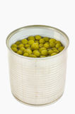Opened can with pea over white background. Stock Images