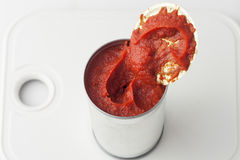 Opened can of tomato paste Royalty Free Stock Photography