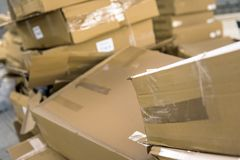 Opened cardboard box in a building Royalty Free Stock Photo