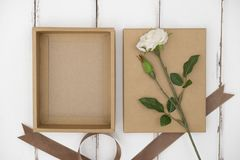 Opened cardboard box on a wooden table royalty free stock images