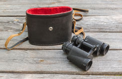 Opened case and a binocular Royalty Free Stock Photos