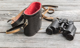 Opened case and a binocular Royalty Free Stock Image