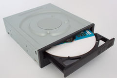Opened CD - DVD drive with a black cap and disk inside.  Royalty Free Stock Photos