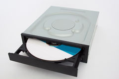 Opened CD - DVD drive with a black cap and disk inside. Isolated Royalty Free Stock Photography