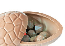 Opened chocolate Easter Egg. On white background Royalty Free Stock Image