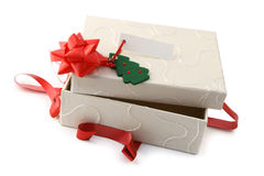 Opened Christmas gift. In white box Royalty Free Stock Photography
