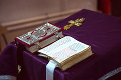 Opened church book and an Orthodox cross. Stock Image