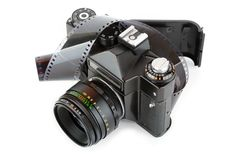 Opened classic manual SLR film camera with film Royalty Free Stock Photo