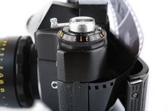 Opened classic manual SLR film camera with film Stock Image