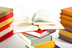 Opened and closed stacked books Stock Image