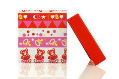 Opened colorful baby gift box with cover Royalty Free Stock Photo