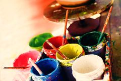 Opened colorful cans with paint. Artist equipment stock photo