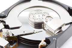 Opened computer hard disk in a case Stock Photos