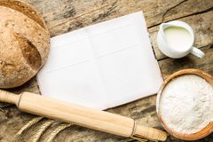 Opened cookbook with bakery background Royalty Free Stock Photo