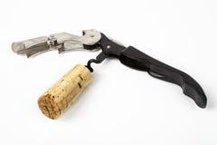 Opened Corkscrew wilh a wine cork Stock Image