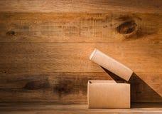 Opened craft box. Ray of light falling on opened craft box royalty free stock photography