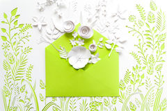 Opened craft paper envelope full of spring blossom sakura paper flowers Royalty Free Stock Image