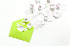 Opened craft paper envelope full of spring blossom sakura paper flowers on white background. top view. concept of love. Royalty Free Stock Image