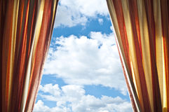 Opened curtain with blue sky Stock Photos