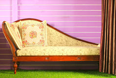 Opened curtain and vintage sofa Royalty Free Stock Photo