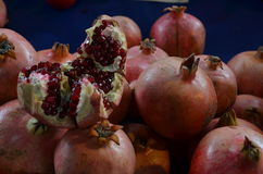 Opened cut pomegranate on the stall among other pomegranates in pazaar turkey antalya royalty free stock image