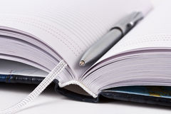 Opened datebook with metallic pen. A datebook and a pen Royalty Free Stock Photography