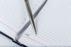 Opened diary with pen Royalty Free Stock Images