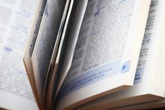 Opened dictionary. Close up pages Royalty Free Stock Photo