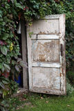 Opened door in the country house Royalty Free Stock Photos